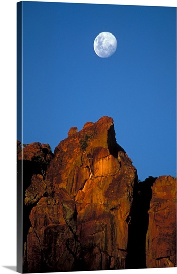 Moon rising over red rock cliffs of Waterberg. Waterberg National Park, Namibia, Africa