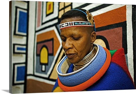 Ndebele woman dressed in traditional costume of a married woman. 