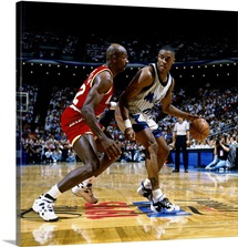 Nick Anderson of the Orlando Magic posts up against Clyde Drexler of the Houston Rockets