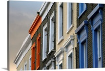 Painted window frames on series of terraced buildings on Camden High Street in London.