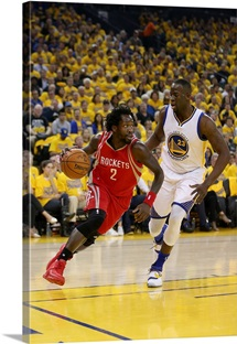 Patrick Beverleyof the Houston Rockets drives on Draymond Green