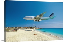 Plane coming in for landing on Maho Bay Beach, Saint Martin, Caribbean
