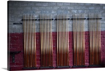 Pool cues in rack