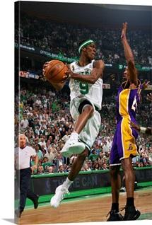 Rajon Rondo of the Boston Celtics looks to pass