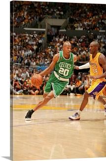 Ray Allen of the Boston Celtics drives against Kobe Bryant