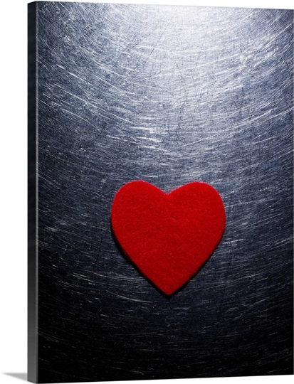 Red Felt Heart on Stainless Steel Background.