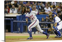 Right fielder Vladimir Guerrero of the Montreal Expos watches the flight of the ball