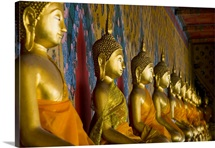 Row of Buddha statues at Wat Arun, Bangkok, Thailand