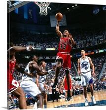 Scottie Pippen of the Chicago Bulls dunks against Karl Malone of the Utah Jazz