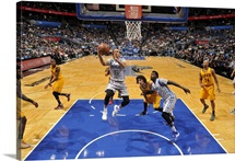 Shabazz Napier of the Orlando Magic goes for the layup