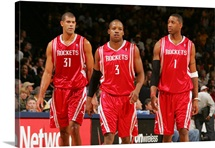 Shane Battier, Steve Francis, and Tracy McGrady of the Houston Rockets take the court