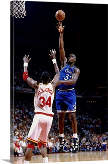 Shaquille O'Neal of the Orlando Magic attempts a shot against Hakeem Olajuwon