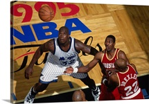 Shaquille O'Neal of the Orlando Magic battles for position