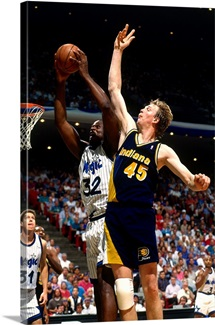 Shaquille O'Neal of the Orlando Magic goes up for a dunk