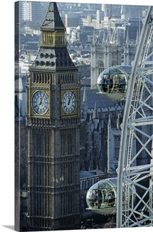 Sightseers look out from the viewing capsules of the London Eye towards Big Ben