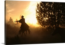 Silhouette of a cowboy on a horse