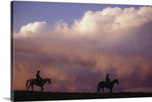 Silhouette of cowboys on horses