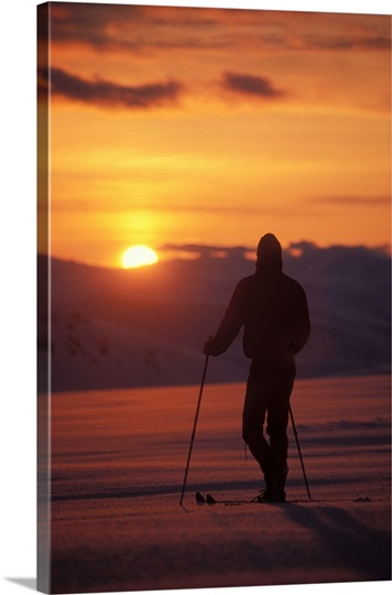 Skier on Mount Douglas at sunset, Aleutian Range, Katmai National Park, Alaska