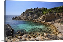 Small deserted beach with clear turquoise water. Mediterranean sea, Corsica, France.