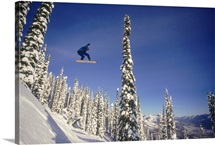 Snowboarder jumping through air, British Columbia, Canada