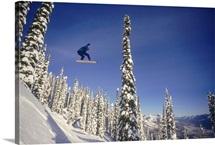Snowboarder jumping through air, British Columbia, Canada