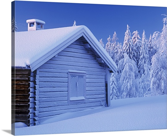 Snowy winter scene in forest with timber house, Dalarna, Sweden