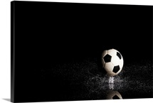 Soccer ball on black reflective surface