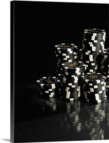Stacks of black and white gambling chips, close-up