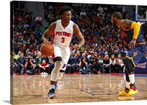 Stanley Johnson of the Detroit Pistons dribbles the ball while guarded by Kyrie Irving