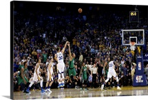 Stephen Curry of the Golden State Warriors attempts a three-point shot