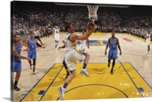 Stephen Curry of the Golden State Warriors drives to the basket