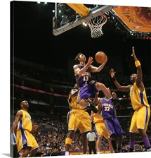 Steve Nash 13 of the Phoenix Suns makes a layup against Lamar Odom