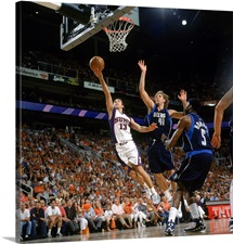 Steve Nash 13 of the Phoenix Suns reaches for the basket