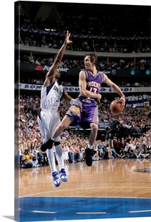 Steve Nash 13 of the Phoenix Suns whips the nifty behind the back pass