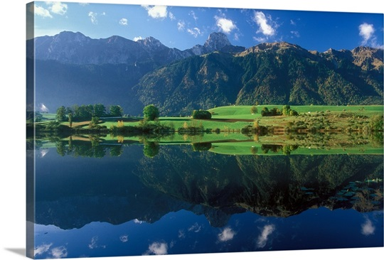 Stockhorn mountain range reflected in Uebeschi Lake, Bernese Alps, Switzerland