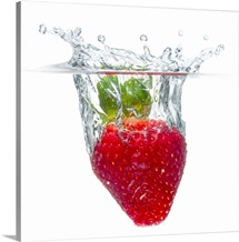 Strawberry fruit splashing and submerged in water