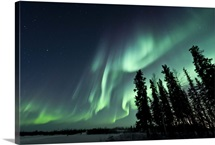 Strong aurora over Walsh Lake, Northwest Territories, Canada.