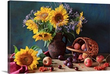 Summer still life with sunflowers, apples, peaches, plums, rowan berries and cherries