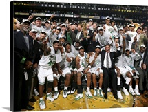 The Boston Celtics organization celebrate with the Larry O'Brien championship trophy