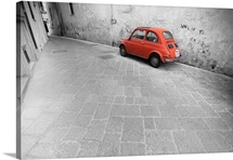 Tiny red vintage car in an Italian alley