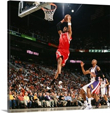 Tracy McGrady 1 of the Houston Rockets takes the ball to the basket for a dunk