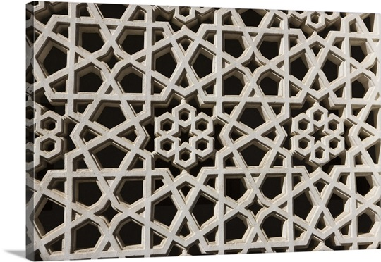 Traditional carved plaster screen on the wall of a dubai