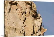 Two men rock climbing a sandstone prow in the San Rafael Swell, Green River, Utah
