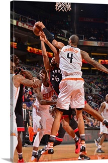 Tyson Chandler of the Phoenix Suns blocks the shot of Cory Joseph