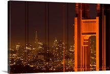 USA, California, San Francisco, Golden Gate Bridge, north tower with cityscape, night