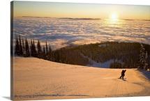 USA, Montana, Whitefish, Young man snowboarding