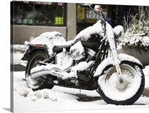 USA, New York City, motorbike covered with snow