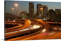 USA, Texas, Houston city skyline and motorway, dusk (long exposure)