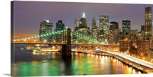 View of Lower Manhattan and the Brooklyn Bridge at Twilight in New York City.
