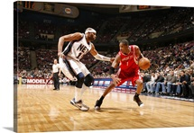 Vince Carter of the New Jersey Nets defends against Tracy McGrady of the Houston Rockets